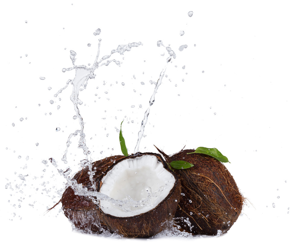 Isolated shot of cracked coconuts with water splash on white background
