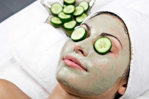 woman laying down on spa bed getting an organic facial